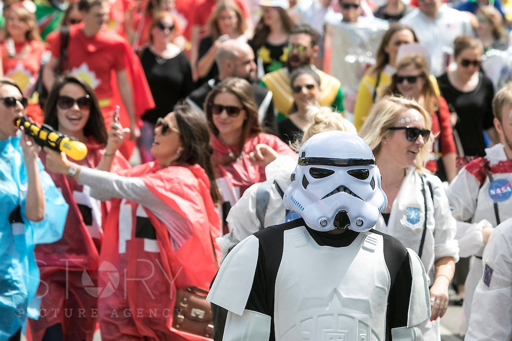 """UNITED KINGDOM, London: 16 May 2015 Thousands of rugby fans make their way to the Marriott London Sevens Rugby tournament at Twickenham Stadium. More than 113,000 fans, most of them in fancy dress, will ascend onto Twickenham for the sporting entertainment. This years fancy dress theme was """"Space"""". Rick Findler / Story Picture Agency"""
