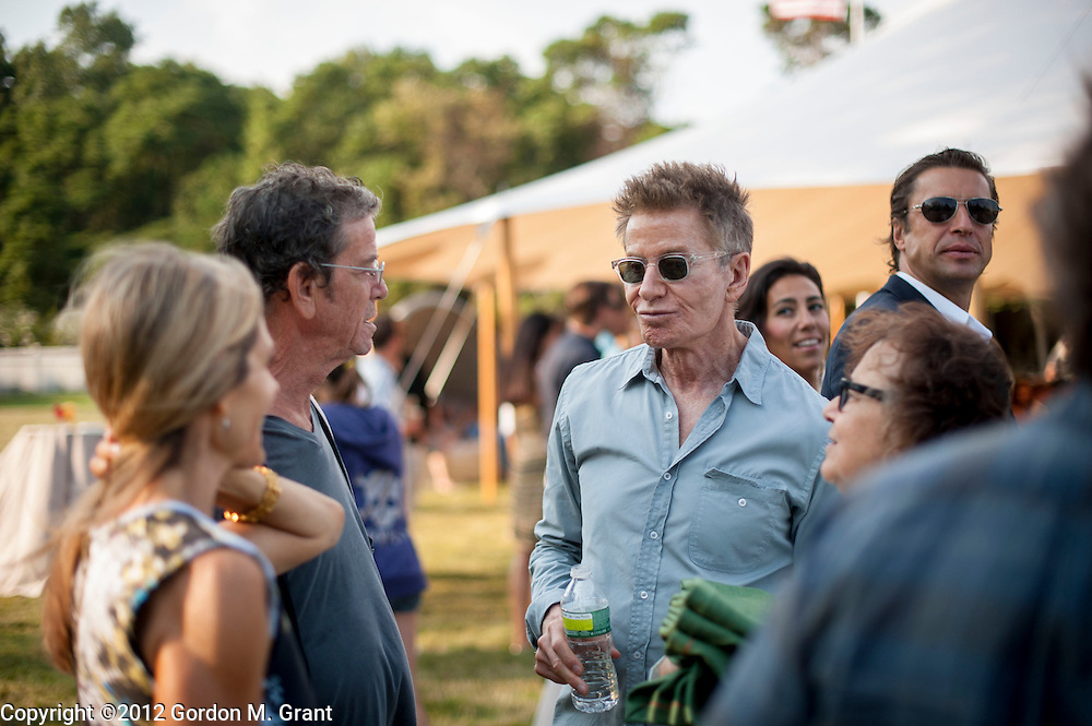 East Hampton, NY - 9/1/12 - Calvin Klein, right, speaks with Lou Reed, left, at the inaugural benefit fundraiser of the Azuero Earth Project, held at the home of artist Cindy Sherman in East Hampton, NY September 1, 2012.     (Photo by Gordon M. Grant)