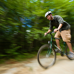 A man (age 19) mountain bikes on a trail in Turner, Maine.  (MR)