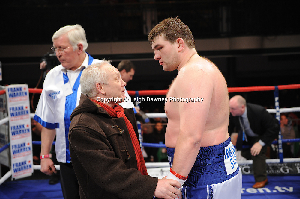BBBofC Southern Area Heavyweight Title. Frank Maloney congratulates John McDermott after defeating Larry Olubamiwo at York Hall, Bethnal Green, London on the 19th February 2011. Frank Warren Promotions. Photo credit © Leigh Dawney.