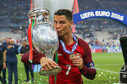 Portugal Forward Cristiano Ronaldo kisses the trophy and celebrates during the Euro 2016 final between Portugal and France at Stade de France, Saint-Denis, Paris, France on 10 July 2016. Photo by Phil Duncan.