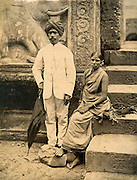 Gentleman and lady on the steps of the Dalada Maligawa in Kandy.<br /> Photograph by Skeen.