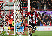 Brentford striker Lasse Vibe scoring Brentford first goal during the Sky Bet Championship match between Brentford and Milton Keynes Dons at Griffin Park, London, England on 5 December 2015. Photo by Matthew Redman.