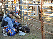 SUN-STAR PHOTO BY BEA AHBECK<br /> Colter Antoantosen appears to be praying before the bareback riding at the rodeo in Merced, Calif. Fri. June 17, 2011.