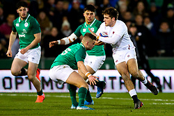 Sam Maunder of England U20 is tackled by Oran McNulty of Ireland U20 - Rogan/JMP - 21/02/2020 - Franklin's Gardens - Northampton, England - England U20 v Ireland U20 - Under 20 Six Nations.