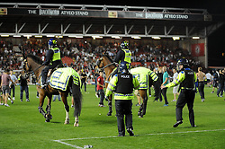 Police keep fans off the pitch  - Photo mandatory by-line: Dougie Allward/JMP - Tel: Mobile: 07966 386802 04/09/2013 - SPORT - FOOTBALL -  Ashton Gate - Bristol - Bristol City V Bristol Rovers - Johnstone Paint Trophy - First Round - Bristol Derby
