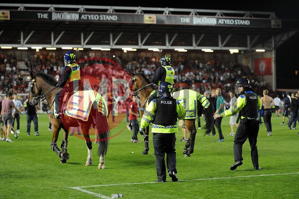 Police keep fans off the pitch  - Photo mandatory by-line: Dougie Allward/JMP - Tel: Mobile: 07966 386802 04/09/2013 - SPORT - FOOTBALL -  Ashton Gate - Bristol - Bristol City V Bristol Rovers - Johnstone Paint Trophy - First Round - Bristol Derby