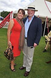 Falklands War veteran SIMON WESTON and his wife LUCY at the Cartier Queen's Cup Polo Final, Guards Polo Club, Windsor Great Park, Berkshire, on 17th June 2012.
