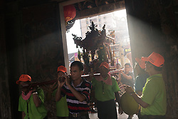 June 05, 2016 - Lukang (Taiwan).  Devotees carry a religious relic inside the Longshan Temple in Lukang. © Thomas Cristofoletti / Ruom