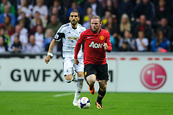 Man Utd Forward Wayne Rooney (ENG) in action during the second half of the match - Photo mandatory by-line: Rogan Thomson/JMP - Tel: Mobile: 07966 386802 17/08/2013 - SPORT - FOOTBALL - Liberty Stadium, Swansea -  Swansea City V Manchester United - Barclays Premier League - First round of the 2013/14 season and the first league match for new Man Utd manager David Moyes.