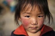 Sherpa boy at Lamjura pass, Solukhumbu, Nepal.