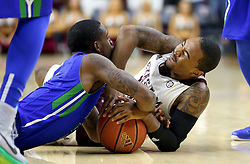 Texas A&M's Anthony Collins (11) fights for a loose ball with Florida Gulf Coast University's Zach Johnson (5) during a NCAA college basketball game in College Station, Texas, Wednesday, Dec. 2, 2015.  (AP Photo/Sam Craft)