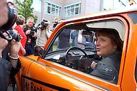 23 AUG 2004, BRANDENBBURG/HAVEL/GERMANY:<br /> Angela Merkel, CDU Bundesvorsitzende, sitzt in einem Auto Marke Trabant, das als Wahlkampfmobil im Landtagswahlkampf Brandenburg dient, vor Beginn der CDU Praesidiumssitzung, Technologie- und Gruenderzentrum Brandenburg an der Havel<br /> IMAGE: 20040823-01-015<br /> KEYWORDS: Präsidiumssitzung, KFZ, Wagen, Trabbi, Fotografen, Kameraleute, Kamera, Camera