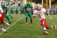 Senior Isaiah Williams (1) with the ball as the Troy Trojans play the Chaminade-Julienne Eagles at the West Carrollton Middle School stadium, Friday, August 26, 2011.