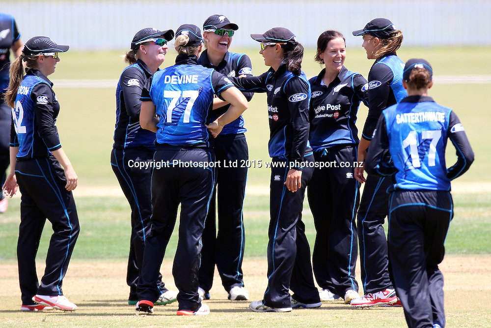 White Ferns celebrate the wicket of Katherine Brunt, 2nd Womens One Day International , New Zealand White Ferns v England at Mount Maunganui, New Zealand. 13 February 2015. Photo credit: Margot Butcher / www.photosport.co.nz