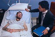 AIDS patient Terry Knapp with Dr. Caiazza in Cabrini Hospital, New York City, 1985.