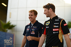 10.10.2014, Sochi Autodrom, Sotschi, RUS, FIA, Formel 1, Grosser Preis von Russland, Training, im Bild Sebastian Vettel (GER) Red Bull Racing and Romain Grosjean (FRA) Lotus F1. // during the Practice of the FIA Formula 1 Russia Grand Prix at the Sochi Autodrom in Sotschi, Russia on 2014/10/10. EXPA Pictures © 2014, PhotoCredit: EXPA/ Sutton Images/ Lundin<br /> <br /> *****ATTENTION - for AUT, SLO, CRO, SRB, BIH, MAZ only*****