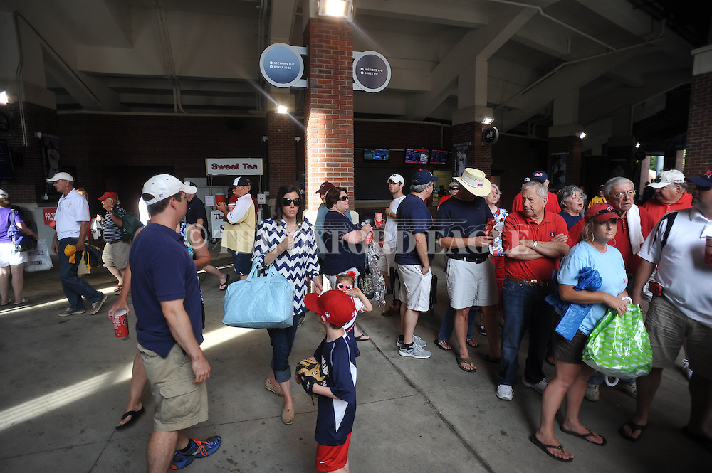 Fans leave the stadium after the Georgia Tech vs. Washington was postponed, at the NCAA Oxford Regional at Oxford-University Stadium on Friday, May 30, 2014. (AP Photo/Oxford Eagle, Bruce Newman)
