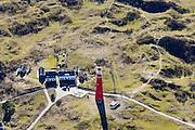 Nederland, Friesland, Schiermonnikoog, 28-02-2016;  Vuurtorenpad met Noordertoren, de rode vuurtoren van het eiland.<br /> Red lighthouse on the island Schiermonnikoog, Wadden sea. <br /> <br /> luchtfoto (toeslag op standard tarieven);<br /> aerial photo (additional fee required);<br /> copyright foto/photo Siebe Swart