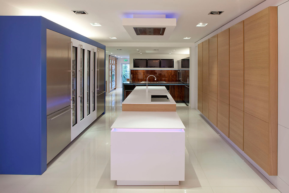 kitchen showroom with wooden units and blue units