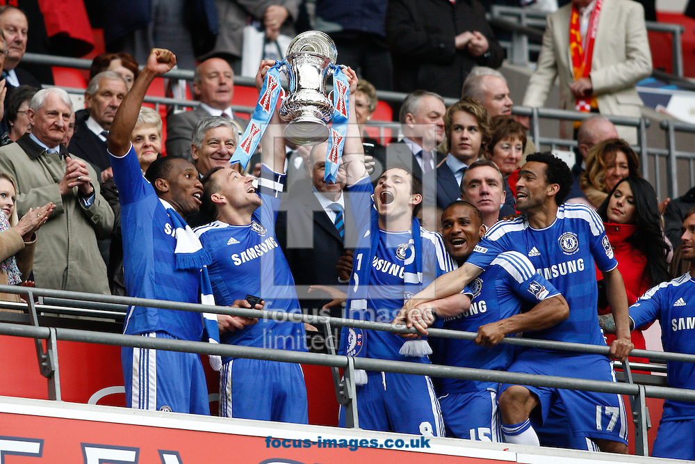 Picture by Andrew Tobin/Focus Images Ltd. 07710 761829. 5/5/12. Drogba, Terry, Lampard Malouda and Bosingwa  lift the FA Cup after winning 2-1 during the FA Cup Final between Chelsea and Liverpool at Wembley Stadium, London
