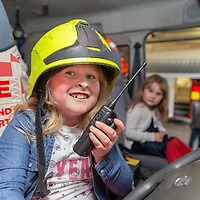 Roisin Kelly, 7, from Gort sits on a Fire Engine during the Shannon Fire and Rescue Open day