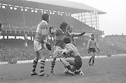 Kerry players stand over Dublin player as he rises after a tackle during the All Ireland Senior Gaelic Football Final, Kerry v Dublin in Croke Park on the 28th September 1975. Kerry 2-12 Dublin 0-11.