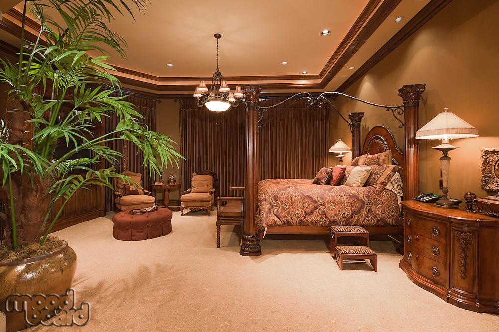 Beautiful chandelier in bedroom of manor house