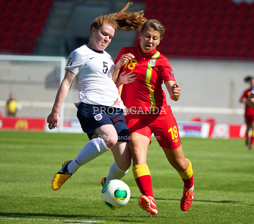 LLANELLI, WALES - Thursday, August 22, 2013: Wales' Emma Jones in action against England's Aoife Mannion during the Group A match of the UEFA Women's Under-19 Championship Wales 2013 tournament at Parc y Scarlets. (Pic by David Rawcliffe/Propaganda)