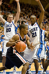 Virginia guard Sean Singletary (44) dribbles past Duke forward Taylor King (20) and guard DeMarcus Nelson (21).  ]The Duke Blue Devils defeated the Virginia Cavaliers 87-65 in men's basketball at Cameron Indoor Stadium on the campus of Duke University in Durham, NC on January 13, 2008.