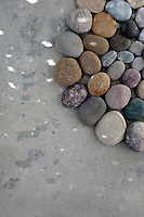 Stone mandala touched by a scattering light pattern.