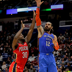 Dec 12, 2018; New Orleans, LA, USA; Oklahoma City Thunder center Steven Adams (12) shoots over New Orleans Pelicans forward Julius Randle (30) during the second quarter at the Smoothie King Center. Mandatory Credit: Derick E. Hingle-USA TODAY Sports