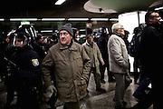 Frankfurt am Main | 02 Feb 2015<br /> <br /> Am Montag (02.02.2015) demonstrierten in Frankfurt an der Hauptwache etwa 60 PEGIDA-Anh&auml;nger mit teils extrem rassistischen Reden und Parolen z.B: gegen &quot;Islamisierung&quot;, an den Aktionen gegen die Rechtsextremisten nahmen mehrere tausend Menschen teil.<br /> Hier: PEGIDA-Aktivisten werden bei ihrem Abmarsch zur S-Bahn von Polizeibeamten besch&uuml;tzt.<br /> <br /> &copy;peter-juelich.com<br /> <br /> [No Model Release | No Property Release]