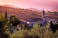 Tuscan church during a colorful sunrise