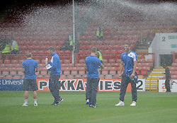 Bristol Rovers players get caught by the sprinklers - Mandatory byline: Neil Brookman/JMP - 07966386802 - 29/08/2015 - FOOTBALL - Matchroom Stadium -Leyton,England - Leyton Orient v Bristol Rovers - Sky Bet League Two