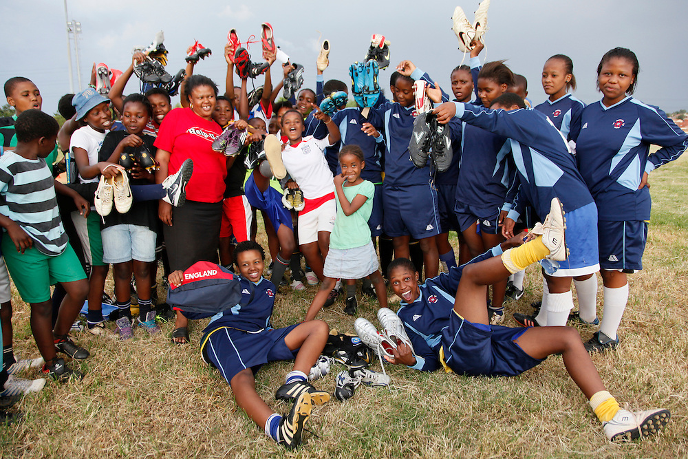 Blue bird ladies team from Alexandra township in Johannesburg receive 40 pairs of soccer boots and kit from Miltoncross secondary school in Portsmouth, UK...© Zute  Lightfoot.