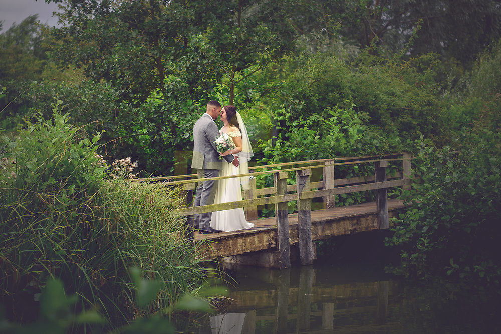 Bride and Groom on Rustic Bridge at Three Lakes, Westmill Farm
