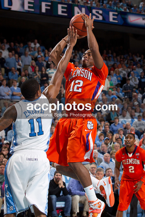 CHAPEL HILL, NC - JANUARY 18: Cory Stanton #12 of the Clemson Tigers shoots the ball over the defense of Larry Drew II #11 of the North Carolina Tar Heels on January 18, 2011 at the Dean E. Smith Center in Chapel Hill, North Carolina. North Carolina won 65-75. (Photo by Peyton Williams/UNC/Getty Images) *** Local Caption *** Cory Stanton;Larry Drew II