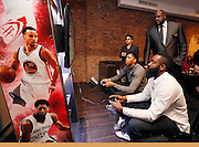 Shaquille O'Neal, right, looks on as Anthony Davis, left, and James Harden, foreground, try their hands at the game during the NBA 2K16 Uncensored Premiere Event at Marquee on Monday, September 21, 2015, in New York. (Photo by Stuart Ramson/Invision for 2K/AP Images)