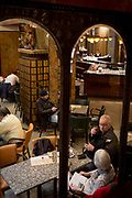 Prague citizens relax in Cafe Lucerna, on 19th March, 2018, in Prague, the Czech Republic. The most elegant of Nove Mesto's many shopping arcades runs through the art-nouveau Lucerna Palace (1920), between Stepanska and Vodickova streets. The complex was designed by Václav Havel (grandfather of the former president), and is still partially owned by the family. It includes theatres, a cinema, shops, a rock club and several cafes and restaurants.