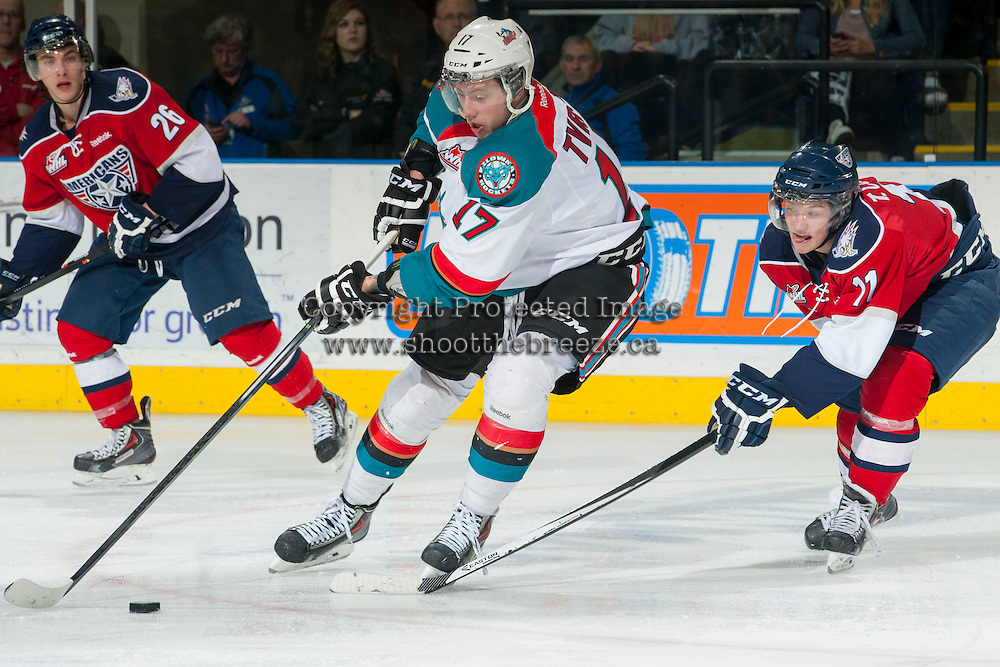 KELOWNA, CANADA - MARCH 8: Marek Tvrdon #17 of the Kelowna Rockets is checked by Ty Comrie #11 of the Tri-City Americans as he skates with the puck on March 8, 2014 at Prospera Place in Kelowna, British Columbia, Canada.   (Photo by Marissa Baecker/Getty Images)  *** Local Caption *** Marek Tvrdon; Ty Comrie;