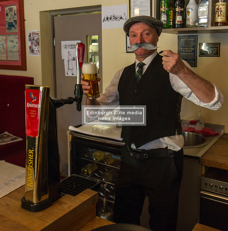 Pictured: Paw Broon<br /> Paw Broon, complete with his iconic flat cap and moustache, linked up with Tommy Miah, owner of the Raj Restaurant in Blackhall, Edinburgh, which is holding an evening of entertainment and food, with recipes straight from 'Maw Broon's Cookbook', with an Indian twist. <br /> Ger Harley | EEm 30 January 2017