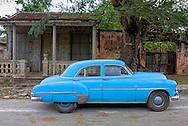 Car and house in Rodas, Cienfuegos Province, Cuba.