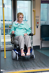 Woman wheelchair user getting ready to leave the tram,