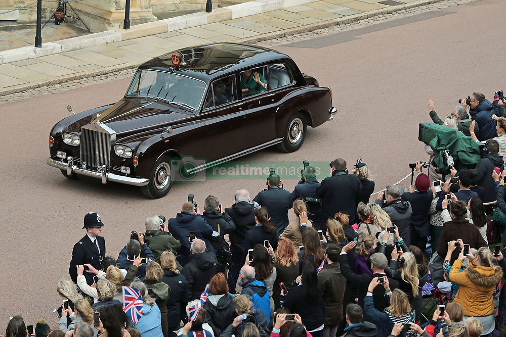 Princess Beatrice and her mother Sarah Ferguson arrive for the wedding of Princess Eugenie to Jack Brooksbank at St George's Chapel in Windsor Castle.