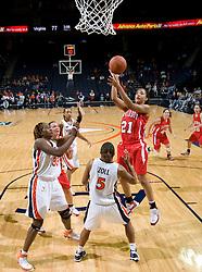 Davidson forward Mercedes Robinson (21) shoots over Virginia guard Sharnee Zoll (5).  The Virginia Cavaliers women's basketball team defeated the Davidson Wildcats 83-68 at the John Paul Jones Arena in Charlottesville, VA on December 20, 2007.