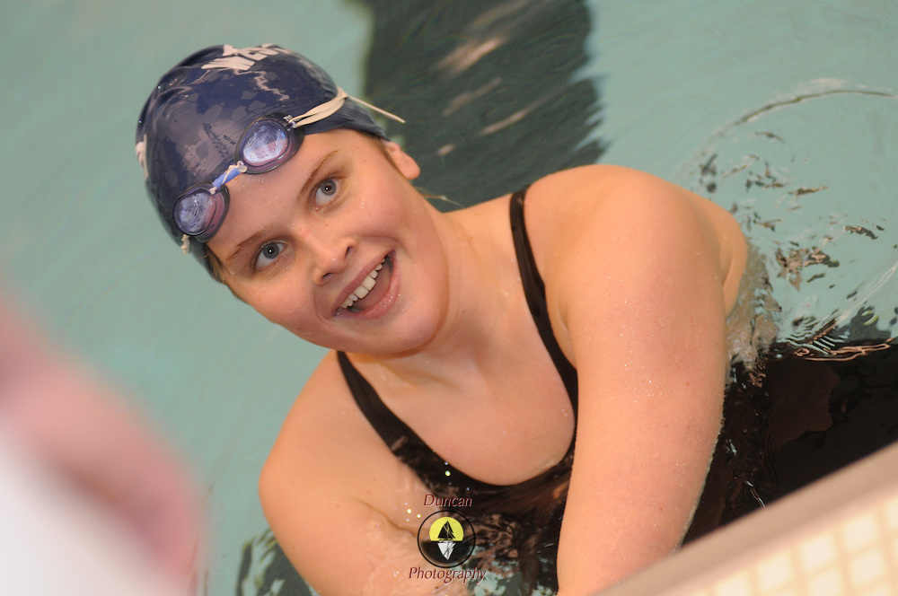 2/21/11 -- BRUNSWICK, Maine.  Maine High School Girls Class A Swimming and Diving Championships at Bowdoin College on Monday night. At the final tally, Bangor came away ahead of Morse by 33 points, who led the 3rd place team, Cheverus, by 68.  Photo © 2011 by Roger S. Duncan.