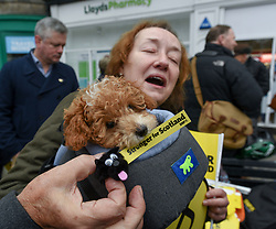 Pictured: Puppy Lola waits for Nicola Sturgeon with owner Joyce Gentle from Leith.<br /> <br /> SNP leader Nicola Sturgeon campaigned in Leith, Edinburgh with SNP candidate for Edinburgh North and Leith Deirdre Brock.<br /> <br /> © Dave Johnston / EEm