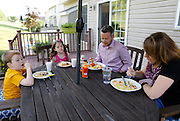Evan, 6, Sarah, 8, John, and Laura Costik have dinner at their home in Livonia, N.Y. on August 27, 2014.<br /> <br /> Evan has type 1 diabetes, and his father, John, modified a continuous glucose monitor and an Android smartphone to provide constant updates on Evan's blood sugar remotely. CREDIT: Mike Bradley for the Wall Street Journal<br /> MEDIHACK