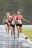 Danelle Woods taking the baton from Bishop, Melissa competing in the women's distance medley relay at the 2007 OTFA Junior-Senior Championships in Ottawa.